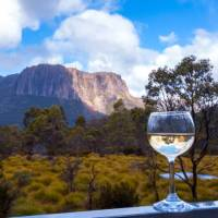 Enjoy a glass of wine after a day's trek along the Overland Track | Great Walks of Australia