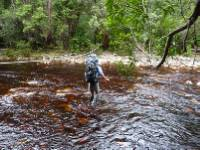 tackling a river crossing on Tasmania's South Coast Track |  <i>Michel Gueneau</i>