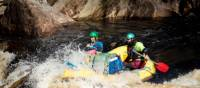 Guides taking the raft through wilder rapids | Glenn Walker