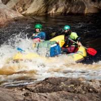 Guides taking the raft through wilder rapids   Glenn Walker