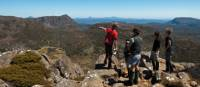 Trekkers enjoying the view with their Tasmanian Expeditions guide from the summit of Mt Jerusalem | Don Fuchs