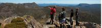Trekkers enjoying the view with their Tasmanian Expeditions guide from the summit of Mt Jerusalem |  <i>Don Fuchs</i>