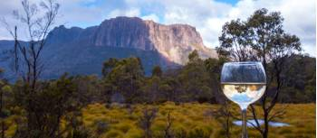 Enjoy a glass of wine after a day's trek on the Overland Track | Great Walks of Australia
